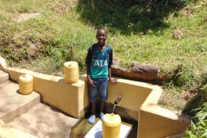 The Water Project: Malava Community, Ndevera Spring -  Leon Fetching Water