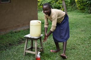 The Water Project: Bukhakunga Community, Mukomari Spring -  Adasia Washing Her Hands