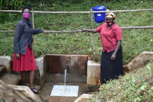 The Water Project: Bukhakunga Community, Mukomari Spring -  Ms Shigali With Ms Pamela At The Water Point