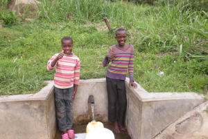 The Water Project: Bukhaywa Community, Asumani Spring -  Kids Give Thumbs Up At The Spring