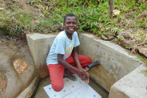 The Water Project: Sambuli Community, Nechesa Spring -  Timothy At The Spring