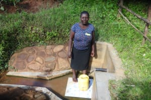 The Water Project: Ibinzo Community, Lucia Spring -  Esther Tea Fetching Water