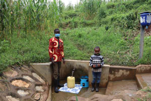 The Water Project: Shihungu Community, Shihungu Spring -  Antony With Newvelly At The Spring