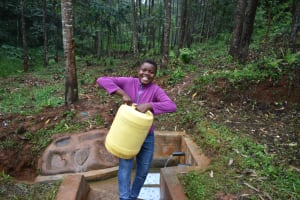 The Water Project: Mukhunya Community, Mwore Spring -  Carrying Water From Mwore Spring
