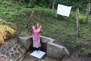The Water Project: Emukangu Community, Okhaso Spring -  Roselyne Waves From The Spring