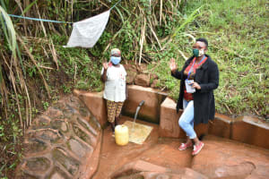 The Water Project: Shisere Community, Francis Atema Spring -  Field Officer Chelagat With Mary At The Spring