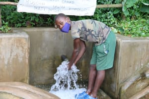 The Water Project: Kambiri Community, Sachita Spring -  Elvis Enjoying Water