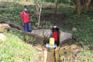 The Water Project: Eshiasuli Community, Eshiasuli Spring -  Esther And Field Officer Christine At The Spring