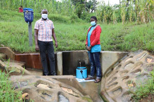 The Water Project: Shihingo Community, Inzuka Spring -  Sharon With Field Officer Jonathan