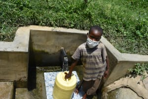 The Water Project: Sambaka Community, Sambaka Spring -  Eveline Fetches Water