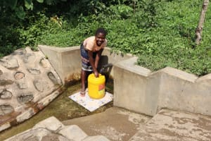 The Water Project: Bung'onye Community, Shilangu Spring -  Uniter Fetching Water