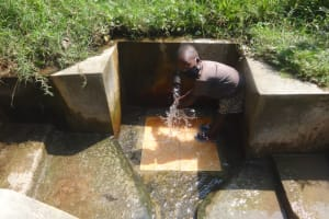 The Water Project: Mubinga Community, Mulutondo Spring -  Peter Enjoying Water From The Spring