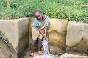 The Water Project: Shamiloli Community, Kwasasala Spring -  Joseph Enjoying The Water