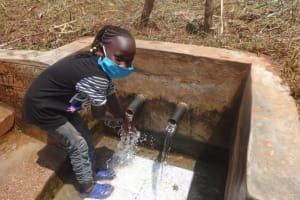 The Water Project: Lutonyi Community, Lutomia Spring -  Vironitana Enjoying The Clean Water