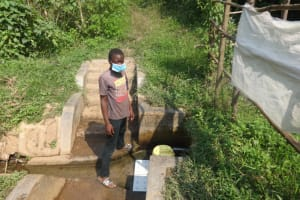 The Water Project: Rosterman Community, Lishenga Spring -  Ezron Fetches Water