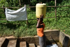 The Water Project: Imbinga Community, Imbinga Spring -  Ruth Leaves For Home With Clean Water