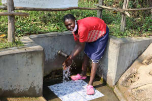 The Water Project: Buyangu Community, Mukhola Spring -  Rhoda Washes Her Hands At The Spring