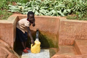 The Water Project: Shisere Community, Richard Okanga Spring -  Ketride Fetching Clean And Safe Water