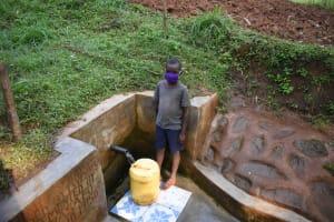 The Water Project: Shamakhokho Community, Imbai Spring -  Ian Fetching Water