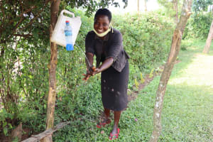 The Water Project: Buyangu Community, Osundwa Spring -  Mercy Robert Washing Her Hands