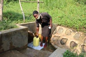 The Water Project: Buyangu Community, Osundwa Spring -  Mercy Fetching Water