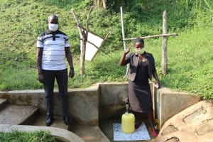 The Water Project: Buyangu Community, Osundwa Spring -  Mercy With Field Officer Jonathan At The Spring