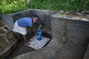 The Water Project: Bukhaywa Community, Ashikhanga Spring -  Anastacia Fetching Water