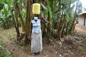 The Water Project: Imusutsu Community, Ikosangwa Spring -  Ruth Carries Water Home