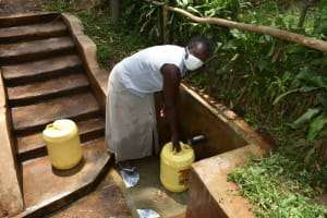 The Water Project: Imusutsu Community, Ikosangwa Spring -  Ruth Fetches Water At The Spring