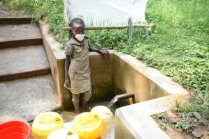 The Water Project: Bumavi Community, Joseph Njajula Spring -  Angie At The Spring