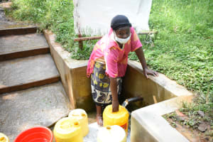 The Water Project: Bumavi Community, Joseph Njajula Spring -  Judith Fetching Water