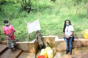 The Water Project: Bumavi Community, Joseph Njajula Spring -  Judith With Angie And Field Officer Georgina