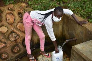 The Water Project: Chepnonochi Community, Shikati Spring -  Marikrus Fetching Water