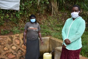 The Water Project: Chepnonochi Community, Shikati Spring -  Nancy With Field Officer Rose