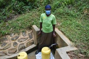 The Water Project: Kisasi Community, Edward Sabwa Spring -  Susan Fetching Water