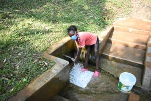 The Water Project: Bumira Community, Madegwa Spring -  Doreen Enjoying Clean Water