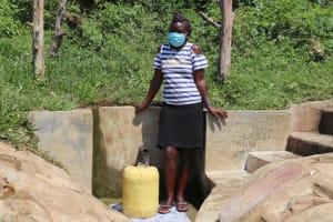 The Water Project: Mukangu Community, Metah Spring -  Rebecca Metah Fetches Water