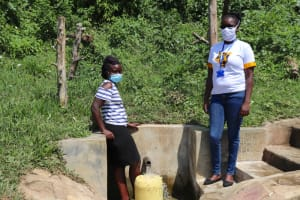 The Water Project: Mukangu Community, Metah Spring -  Rebecca And Field Officer Olivia Bomji