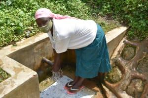 The Water Project: Kimarani Community, Kipsiro Spring -  Everlyne Washing Her Hands