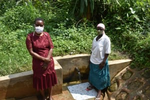 The Water Project: Kimarani Community, Kipsiro Spring -  Field Officer Rose With Everlyne