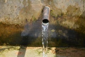 The Water Project: Kimarani Community, Kipsiro Spring -  Clean Water Flows