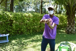 The Water Project: Shianda Township Community, Olingo Spring -  Trainer David Shows Ten Steps Of Handwashing