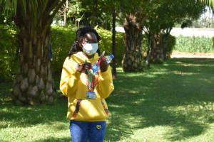 The Water Project: Shianda Township Community, Olingo Spring -  Trainer Elvin Leads Dental Hygiene Session