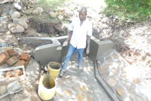 The Water Project: Shianda Township Community, Olingo Spring -  Plasterwork