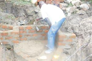 The Water Project: Shianda Township Community, Olingo Spring -  Setting The Pipe