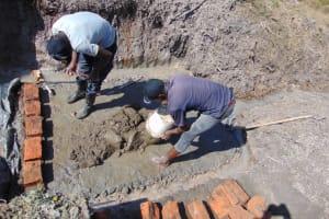 The Water Project: Machemo Community, Boaz Mukulo Spring -  Brick Setting