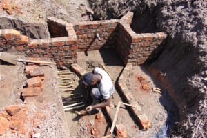 The Water Project: Machemo Community, Boaz Mukulo Spring -  Creating Water Diversion Channels