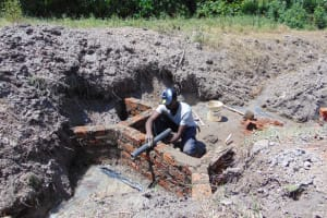 The Water Project: Machemo Community, Boaz Mukulo Spring -  Pipe Setting