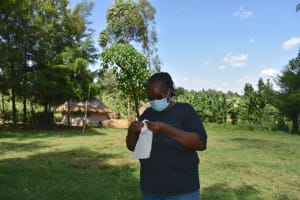 The Water Project: Machemo Community, Boaz Mukulo Spring -  Trainer Patience Shows How To Make A Face Mask