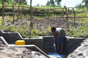 The Water Project: Machemo Community, Boaz Mukulo Spring -  Woman Drinking Water
